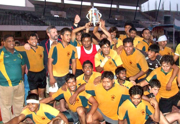 Members of Delhi Hurricanes lift the trophy after winning the Callaghan Cup All-India Division-II Rugby Tournament in Bhubaneswar on <b>Oct 29, 2009.