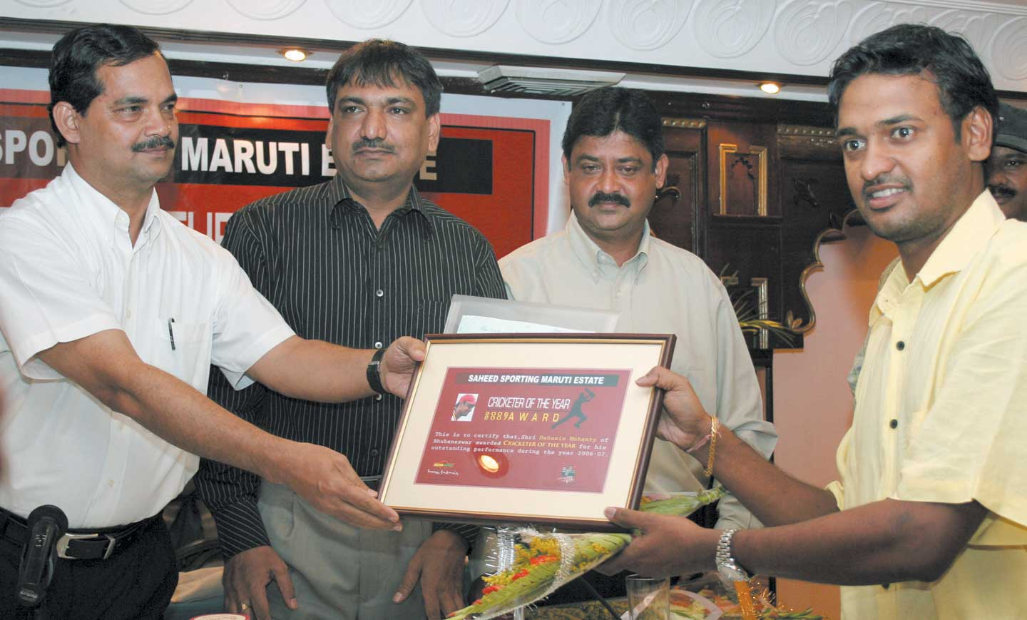 World Cupper Debasis Mohanty (Right) receives the Maruti Estate Saheed Sporting Cricketer of the Year Award in Bhubaneswar on April 16, 2008.