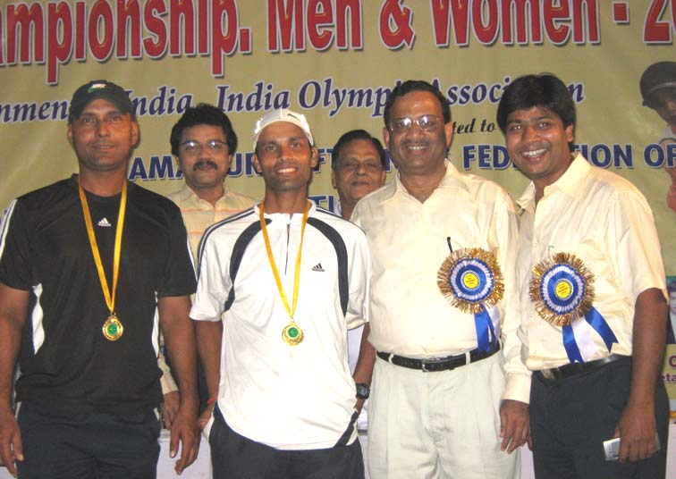 Men`s double champions Lalit Dash and Ajay Nishank receive their medals at the 7th Senior National Soft Tennis Championship in Bhubaneswar on <b>Nov 19, 2009.